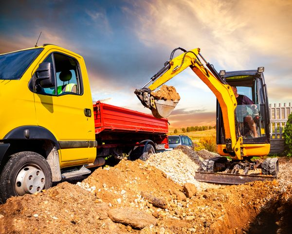 small excavator and truck undertaking excavation works