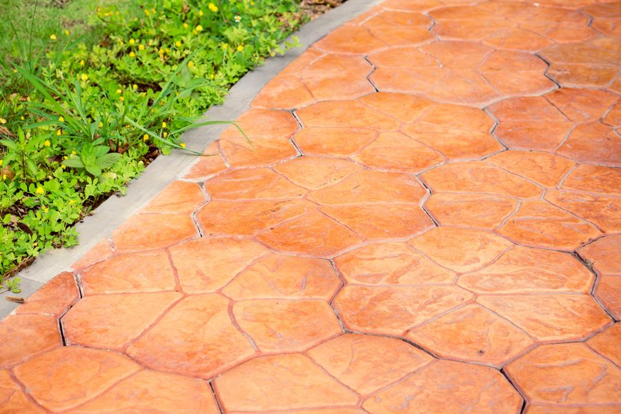Orange stamped concrete footpath with blue edging